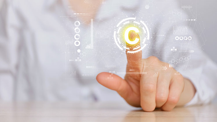 man pointing his index finger on C symbol on the screen