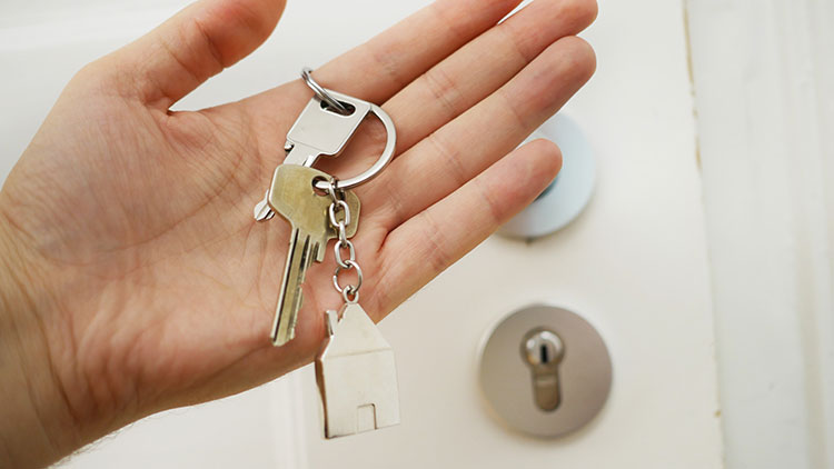 a person hand holding keys