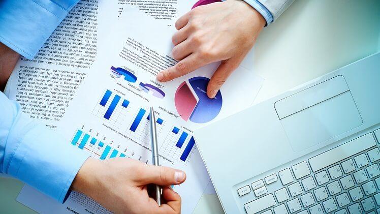 men pointing finger, pen at business docs