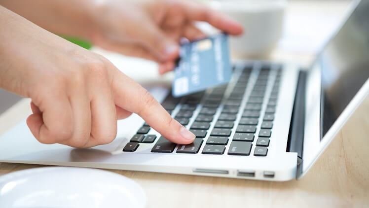entering bank account, credit/debit card information by using a laptop