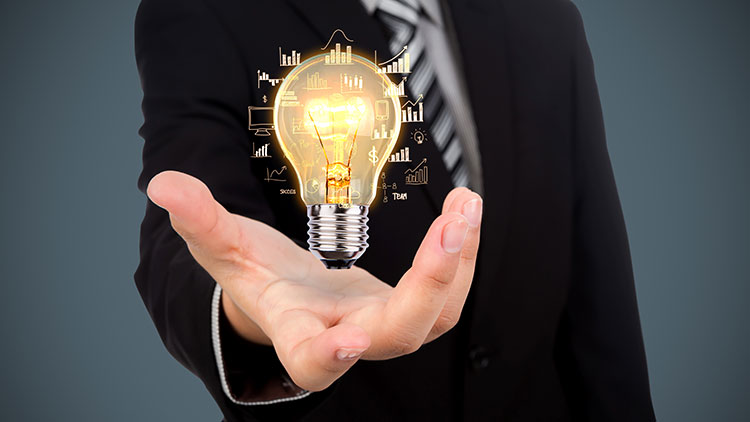 man holding light bulb in his hand
