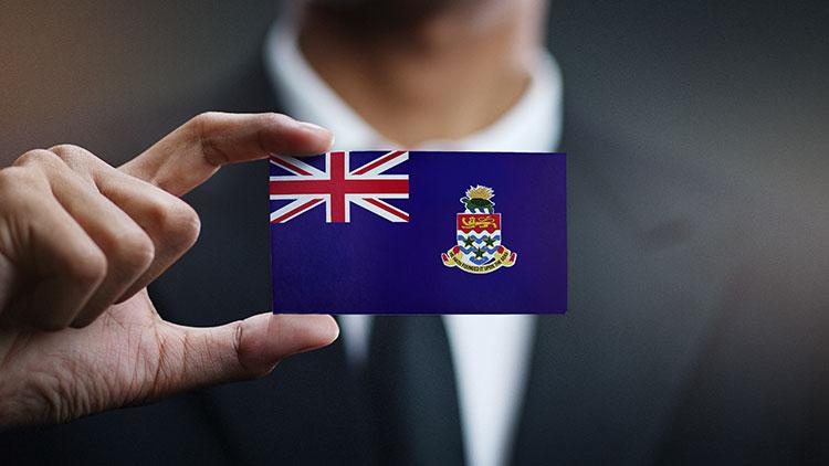 man holding flag of cayman islands