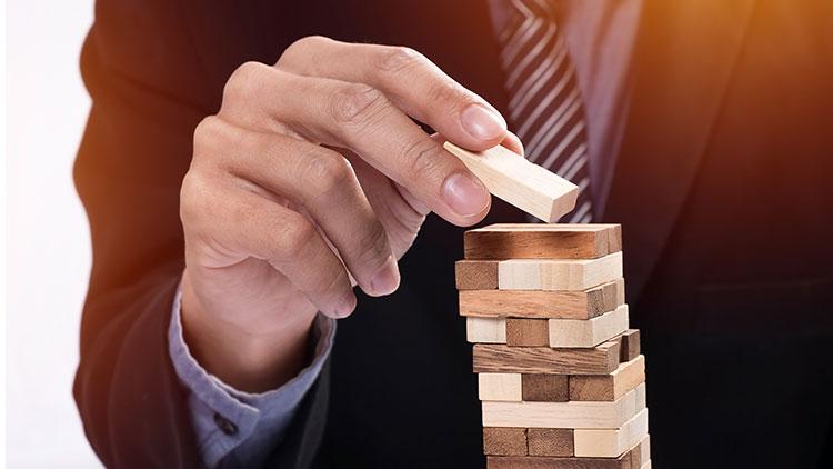 a man assemble wooden block