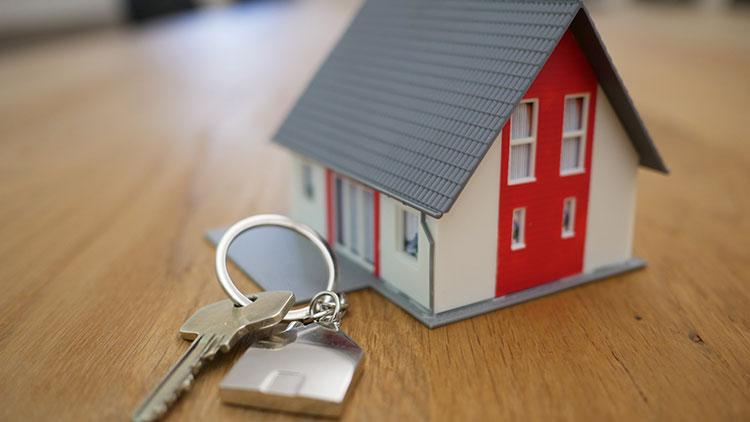 house figure and house key