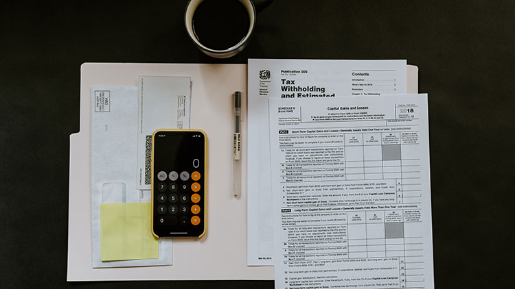 tax papers with calculator