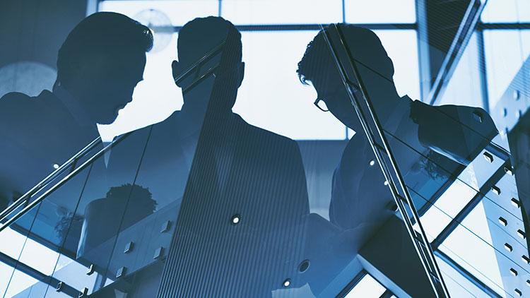 reflection of businessmen