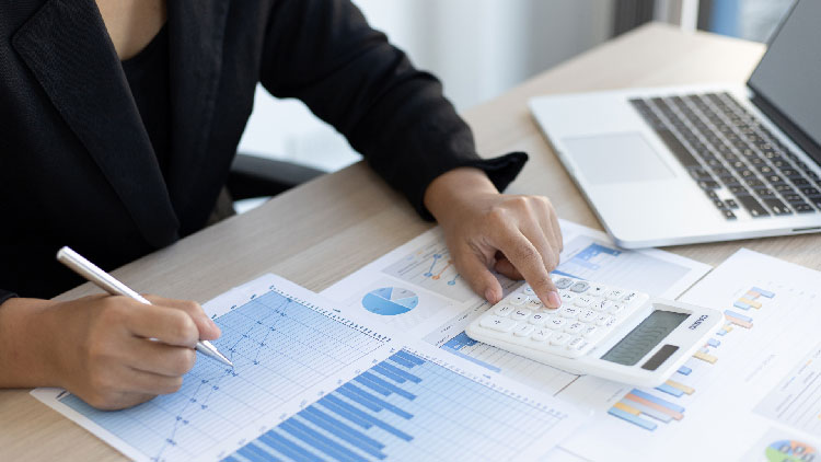 a woman calculating financial report